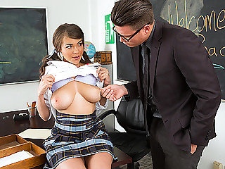 Busty schoolgirl rides on big cock and..